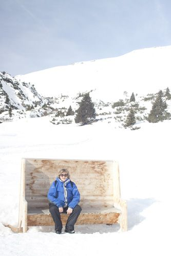 Amanda Goldton resting a while, enjoying the sunshine, on the winter hiking trail from Naraus to Startgels in the Laax snow and rski resort area of Graubunden, Switzerland ©Gregory Goldston