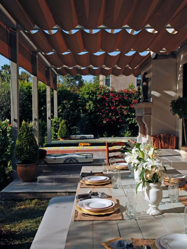 Anne Heche's Shade Solution - When actress Anne Heche and her husband asked Jamie Durie to create more shade in their too-hot backyard, he delivered with this house-length pergola fitted with adjustable Roman shades on the top and sides.   Make Shade: Canopies, Pergolas, Gazebos and More on HGTV