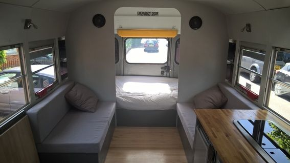 Check out this site for a school bus conversion with clean lines and minimalist design.