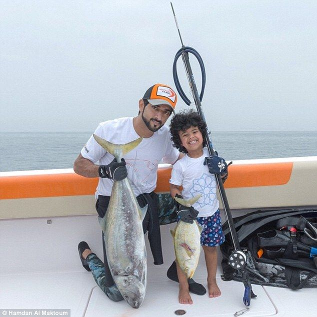 Good catch: Hamdan and Mohammed show off the results of a fishing trip