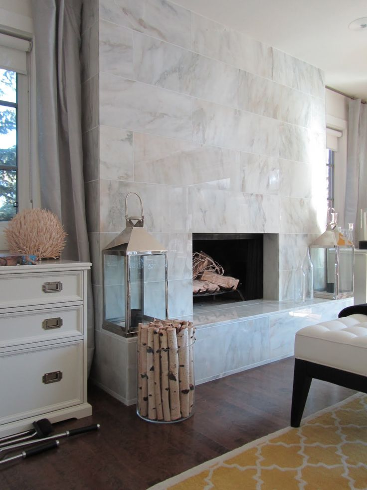 gorgeous living room with ann sacks opera x modern marble fireplace windows flanking fireplace covered in platinum silk curtains window panels