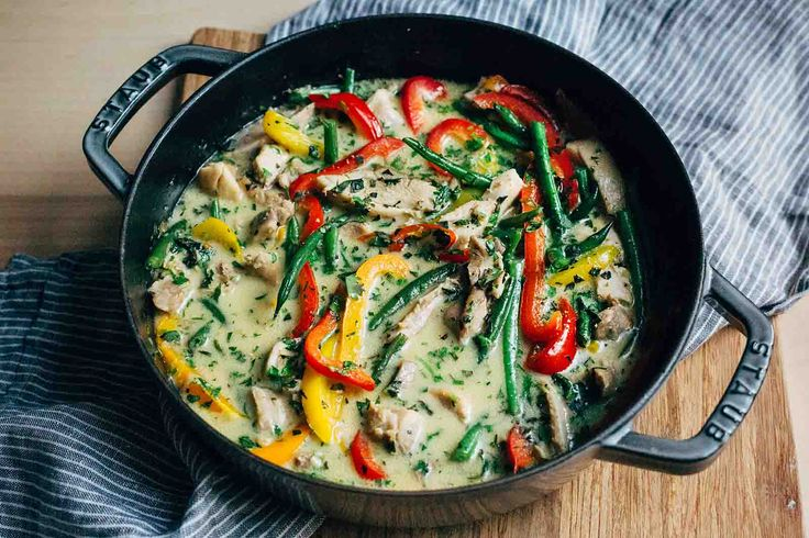 Thai Green Curry Chicken ~ Skip ordering take-out! This weeknight curry is made with an easy homemade paste, coconut milk, chicken, bell peppers, and green beans. #MadeinStaub Cocotte ~ SimplyRecipes.com