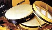 Bodhráns:  The Bodhrán is a very old traditional Irish drum made from goatskin wrapped around a wooden frame. It is played with a double ended beater called a Cipin.