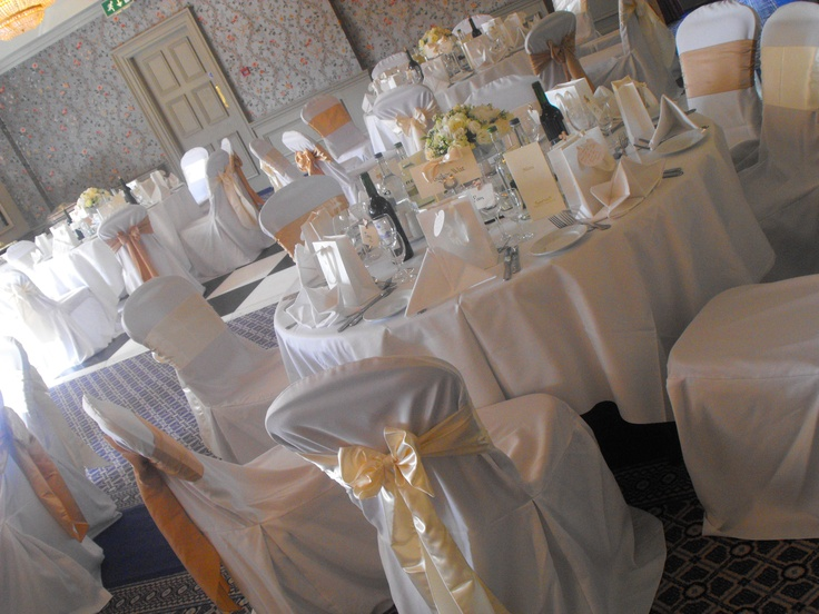 Mixed Golds, Champagnes and Ivory Satin Bows on White Chair Covers