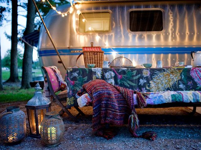 "Cozy Accessories  Also stored in the Wandering Star? Sarah's table linens, lanterns, string lights, candles, throws, rugs and outdoor accesories. ""Bringing beauty and comfort to the outdoors while camping is a must,"" she wites."