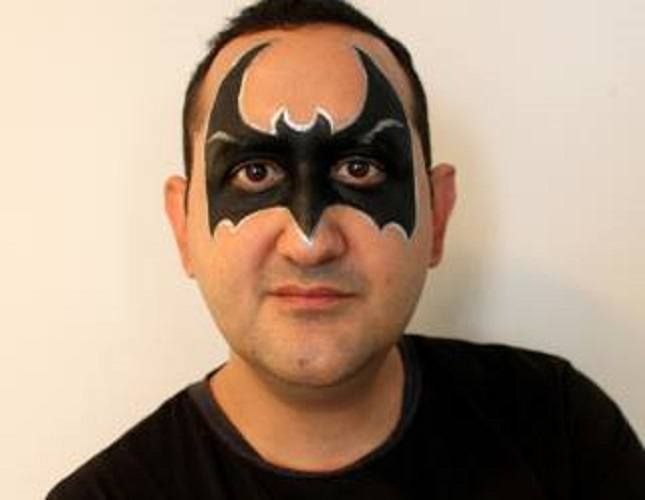 An Adult Batman Face Painting