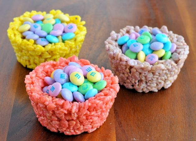 Rice krispie treats with food coloring, pressed into a muffin tin.  Use a bottle to make an even indentation.  After cool, fill with pastel M  Tried this morning - you'll need more food coloring than you think.  What looks bright pink as just marshmallows and butter turns into a light pink once you add the rice krispies.