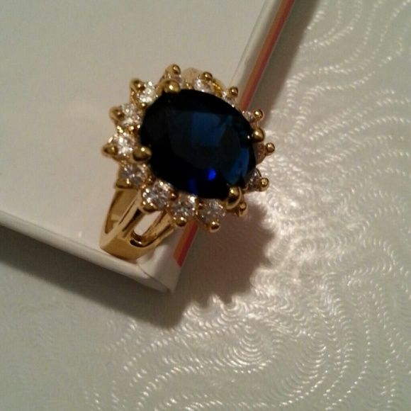 Gold Ring Beautiful costume jewelry ring with beautiful blue stone. Reposh it is way to small for me. Jewelry Rings