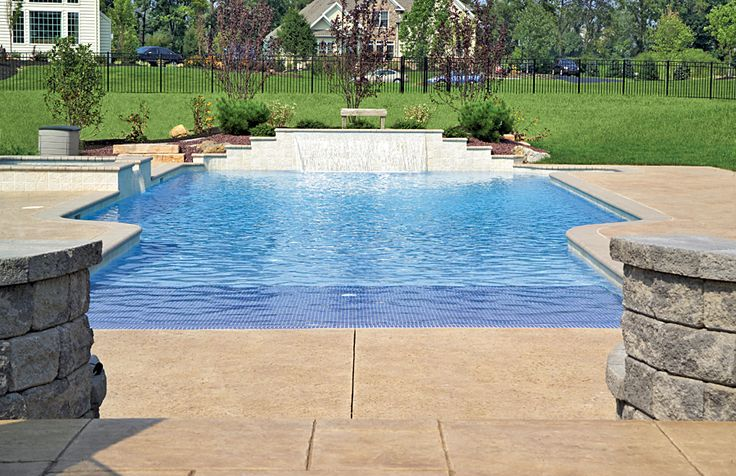 Modified rectangle pool with spa, tiled beach-entry with cascade waterfall.