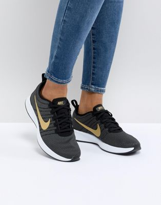 super popular 9a4b4 47249 Nike Dualtone Racer Trainers In Black And Gold