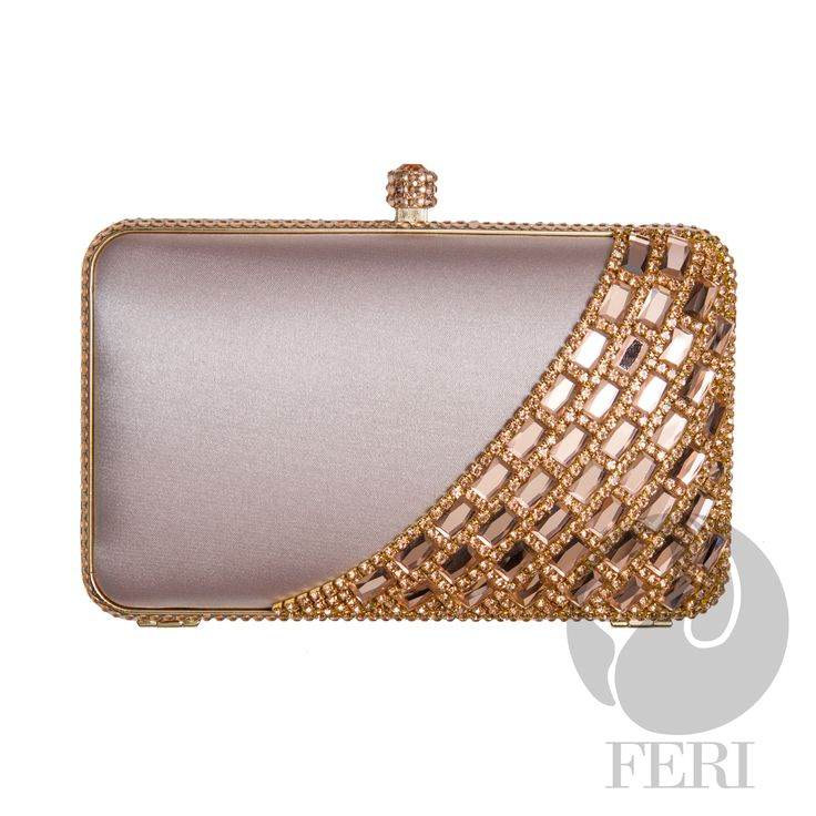 "FERI Day2Day - Mae - Evening Clutch - Champagne - Champagne satin lined box clutch - Embellished with gold toned metal, champagne coloured baguette and round stones - Mirror-like facets give amazing colour and shine - Push top locking closure - Custom FERI lining with interior pouch - Dimension: 6.5"" x 3.94"" x 1.26"" (Width x Height x Depth)  Invest with confidence in FERI Designer Lines.   www.gwtcorp.com/ghem or email fashionforghem.com for big discount"