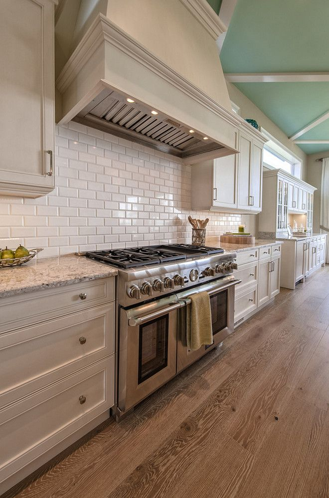Off White Kitchen Cabinet With Wire Brushed White Oak Flooring And Robin Egg