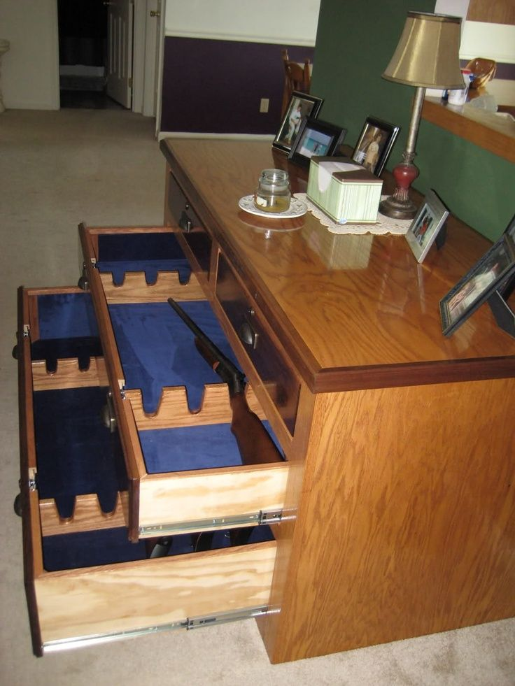 use an old dresser for a homemade gun cabinet.. No one would ever know if you didn't tell them!  SMART!