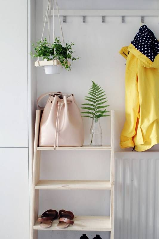 ladder shelf storage A clever storage solution that utilizes vertical space in lieu of valuable floor square footage.