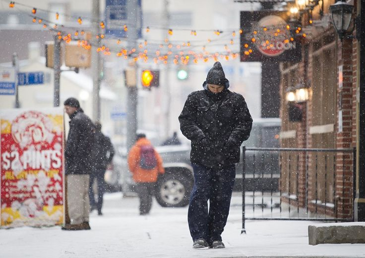 Pedestrians in the snow on Second Street in Downtown Harrisburg. Snow and sleet hit the Midstate Monday afternoon and is expected to continue through the evening.  Monday, February 15, 2016.  Daniel Zampogna, PennLive
