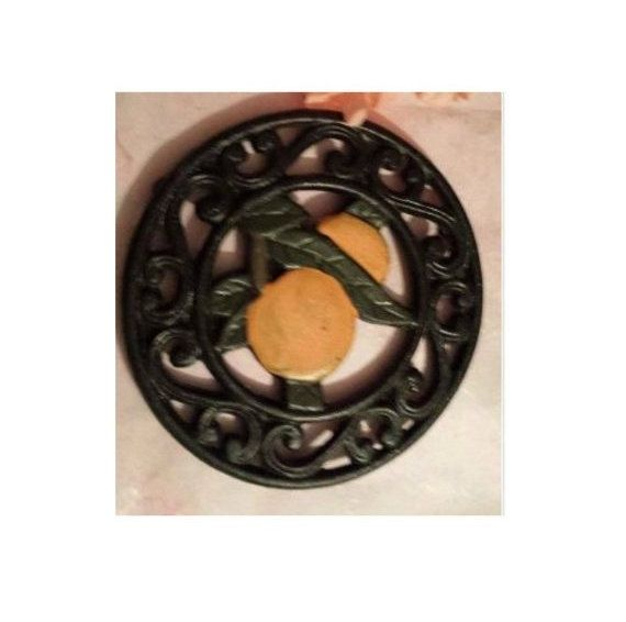 Vintage Cast Iron Trivet,  Ornate Round Trivet,  Hand Painted Oranges, Kitchen Decor, Early American, Primatives, Hot Plate, Florida Orange by JunkYardBlonde on Etsy #vintagetrivet #castirontrivet #castiron #oranges #orangetrivet #floridaoranges #rustic #primative #florida #hotplate
