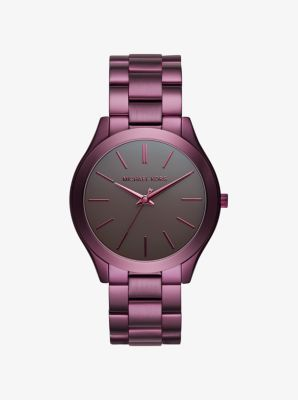 iconic Runway watch gets a polished, plum-hued refresh. Let the stylish stainless steel setting pop opposite gold-tone extras.