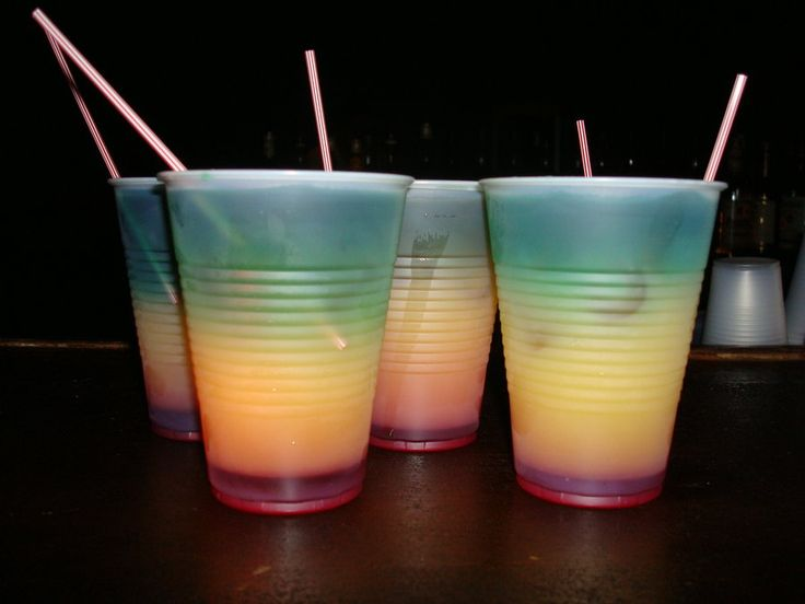 Bob Marley Drink! Grenadine at the bottom, creme de menthe in the middle, and 151 plus creme de bananna, so it makes the red, green and yellow of the Jamaican flag. Light it on fire, stick a straw down to the bottom and finish it!