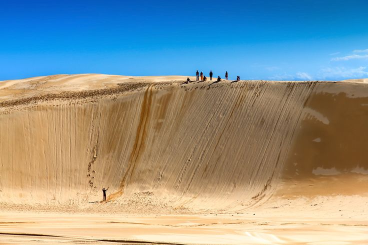 steep sand dune pursued - 736×490