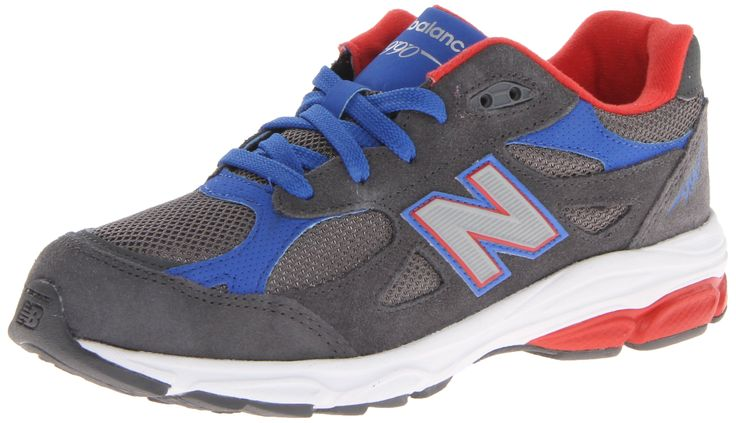 New Balance KJ990 Grade Running Shoe (Big Kid),Dark Grey/Red/Blue,6 M USBig Kid. Running shoe featuring mesh upper with suede overlay and injection-molded EVA midsole. Reflective detailing. Rubber outsole.