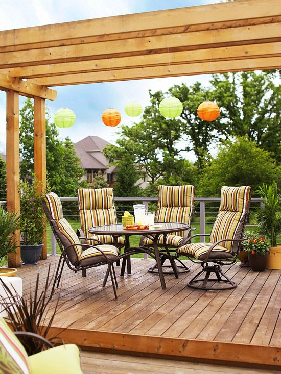 Small backyard platform deck pergola and ambient lighting create a cozy and comfortable outdoor dining