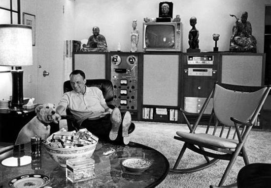 "Frank Sinatra with latest ""Hi-Fi"" equipment...huge speakers, reel to reel film, TV and amplifiers, etc."