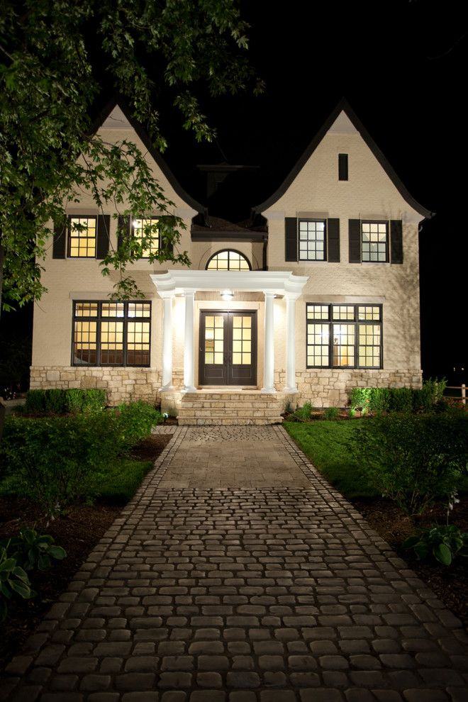 Brick walkway exterior traditional with outdoor lighting stone steps white pillar stucco siding