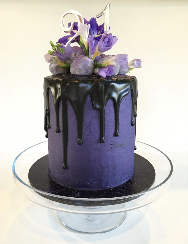Elegant Black and Purple Drip Cake // Dark chocolate mud cake, blackberry buttercream, dark chocolate ganache drip, topped with white chocolate and blackcurrant truffles, and fresh flowers.