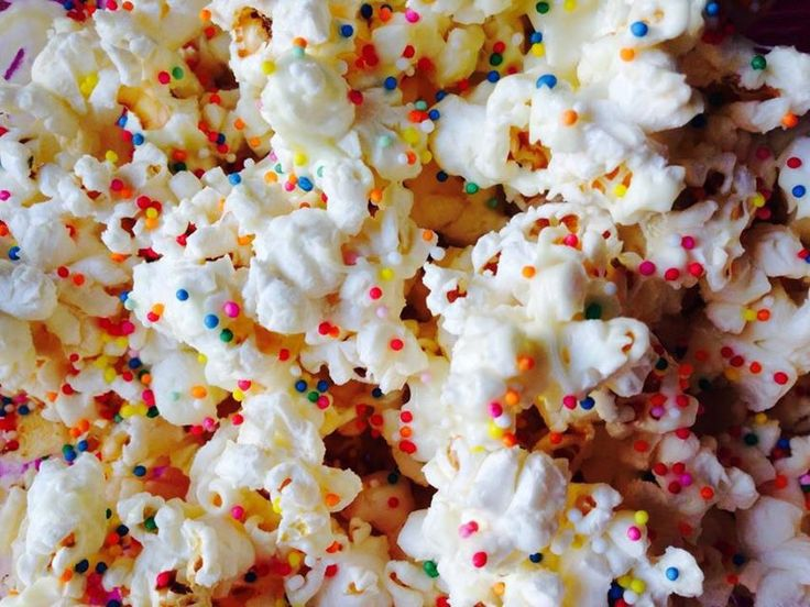 Sprinkle Popcorn   White Choc drizzled over wit 100's&1000's sprinkled overtop