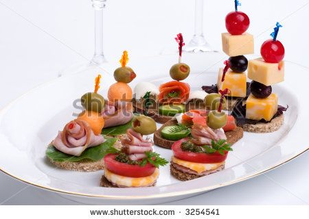 Canape sandwiches assorted canapes sandwiches on plate for Types of canape