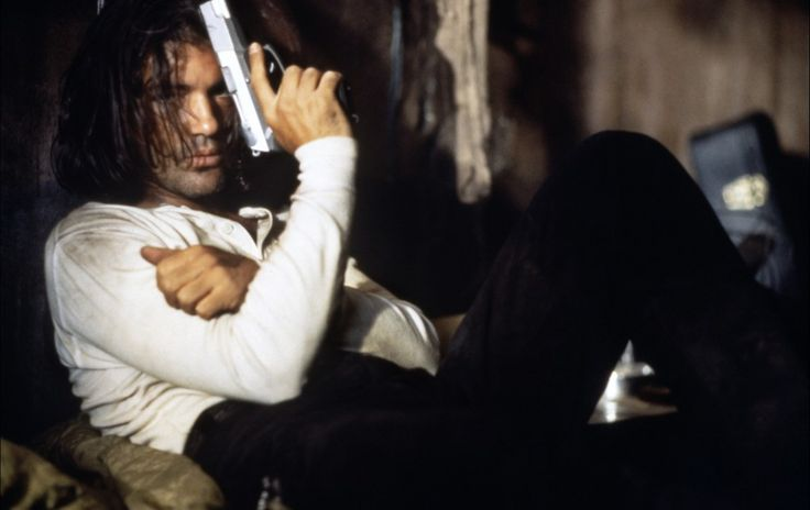 Antonio Banderas - Desperado, I so loved this movie when he got on the bar and played! So sexy!!
