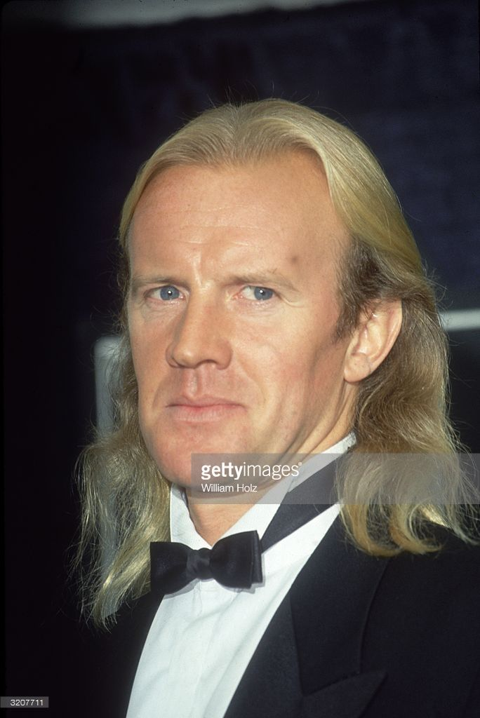 Headshot of Russian-born Bolshoi Ballet dancer Alexander Godunov posing in a tuxedo at a Movie Awards ceremony. Godunov had defected to the US from the USSR twelve years earlier.