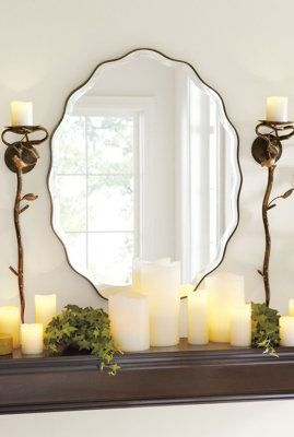 Above a mantel or a vanity, our oval mirror is made more shapely with a graceful, scalloped edge.