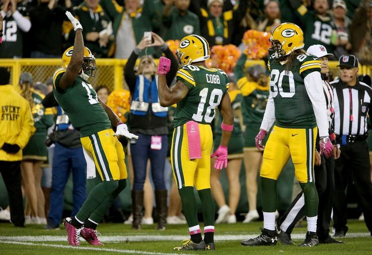 23-16, Packers:    Davante Adams, Randall Cobb and Justin Perillo of the Green Bay Packers celebrate after Adams scored a touchdown in the second quarter against the New York Giants at Lambeau Field on Oct. 9, 2016 in Green Bay, Wis.