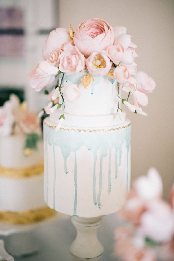 Pretty Pastel Wedding Cakes for Your Spring Wedding | We're not sure if it's the dusty blue drippings or the editable pastel blooms, but this dessert makes our heart skip a beat. It's perfect for a romantic spring wedding!