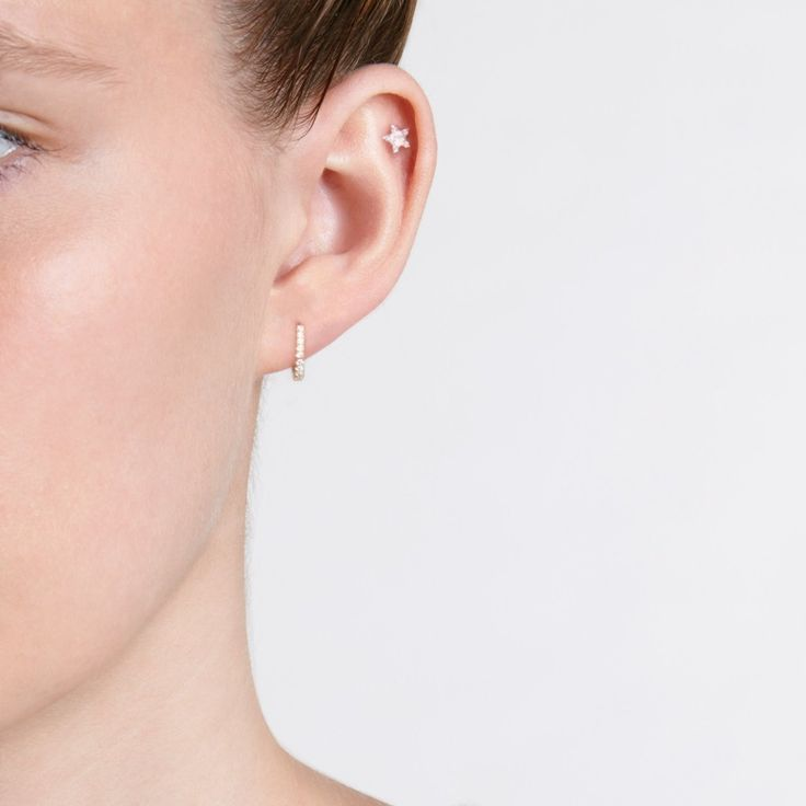Sized bigger to accommodate the wider parts of the ear, this 22-diamond huggie earring by Maria Tash is elegant and discreet.