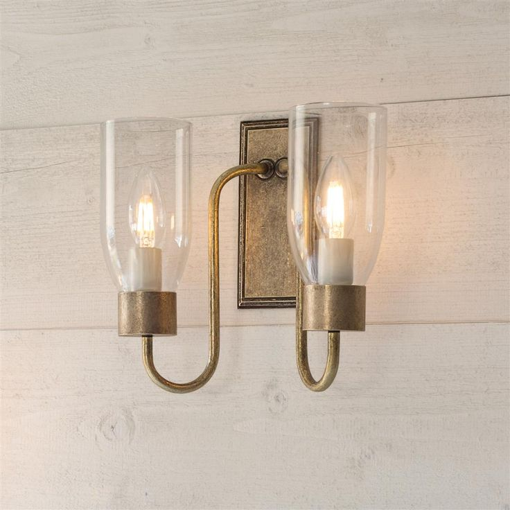 double morston wall light in antiqued brass with clear glass