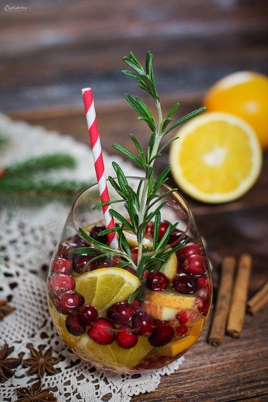 Winter wedding cocktail idea - winter sangria with fun red + white straw {Courtesy of Cooking Catrin}