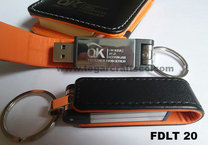 FDLT20: A flashdrive with leather cover and branding logo. It's a merchandise that you want to share to all your colleagues.