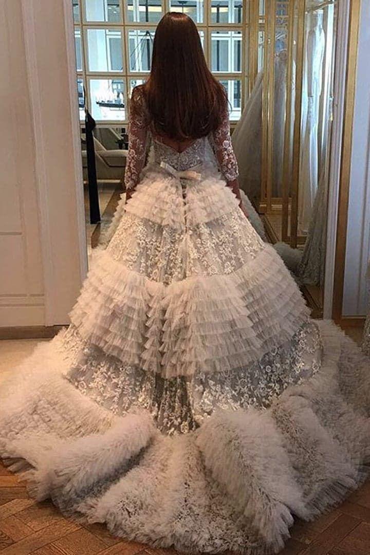 Pin for Later: Ihr kennt sicher das Gesicht dieser Braut — doch wartet ab bis ihr ihr Hochzeitskleid seht