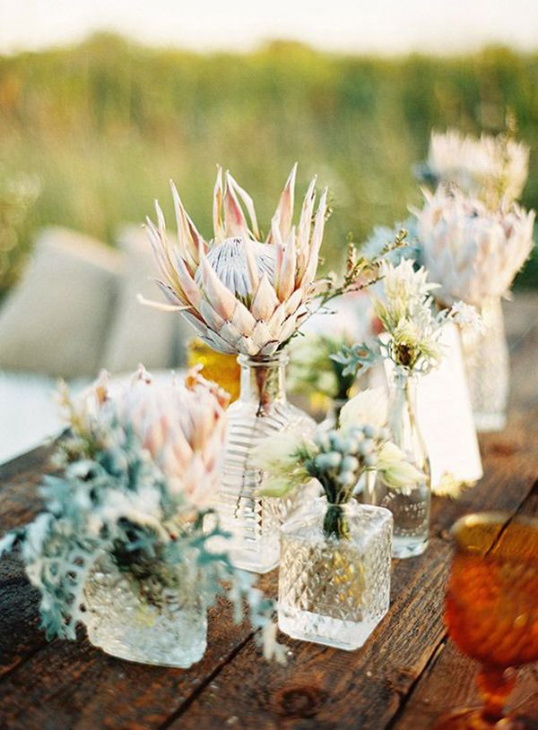 Botanical Centerpieces in Vintage Crystal Decanters on a Farm Table | Olivia Leigh Photography | Earthy and Elegant Rustic Wedding in Dusty Blue and Taupe - http://heyweddinglady.com/earthy-elegant-rustic-wedding-dusty-blue-taupe