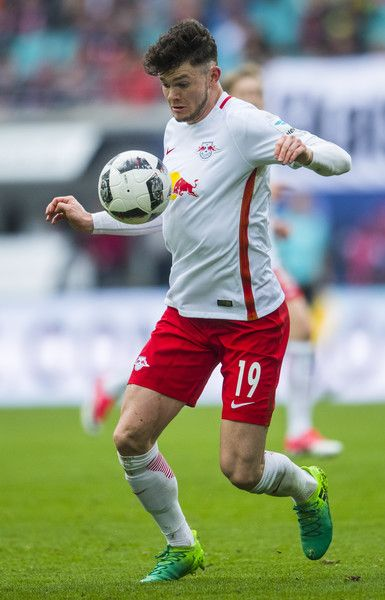 Leipzig's Scottish midfielder Oliver Burke plays the ball during the German first division Bundesliga football match between RB Leipzig and Bayer 04 Leverkusen in Leipzig, eastern Germany, on April 8, 2017.  / AFP PHOTO / ROBERT MICHAEL / RESTRICTIONS: DURING MATCH TIME: DFL RULES TO LIMIT THE ONLINE USAGE TO 15 PICTURES PER MATCH AND FORBID IMAGE SEQUENCES TO SIMULATE VIDEO. == RESTRICTED TO EDITORIAL USE == FOR FURTHER QUERIES PLEASE CONTACT DFL DIRECTLY AT + 49 69 650050.