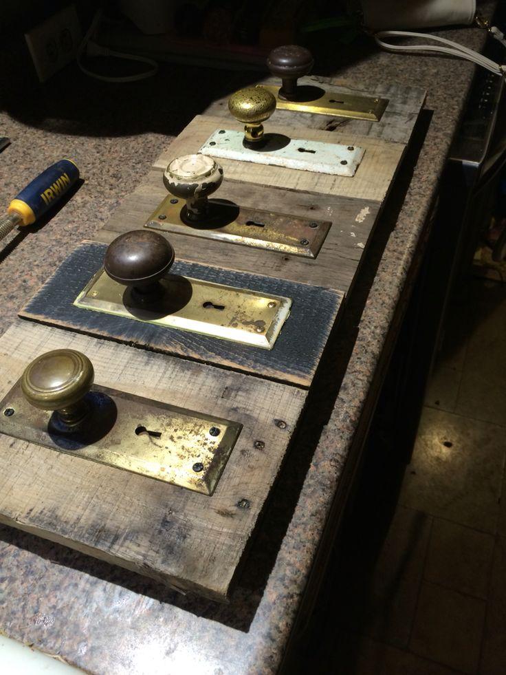 Coat rack with old door knobs and scrap wood