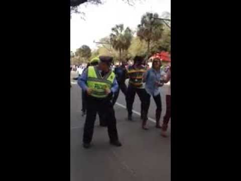 He's got the moves for a dapper older man! Love it!   New Orleans Police officer -Wobble dance Mardi Gras 2014 - YouTube