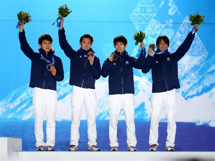 Bronze medalists Reruhi Shimizu, Taku Takeuchi, Daiki Ito and Noriaki Kasai of Japan celebrate during the medal ceremony for the Men's Team Ski Jumping on day 12 of the Sochi 2014 Winter Olympics at Medals Plaza