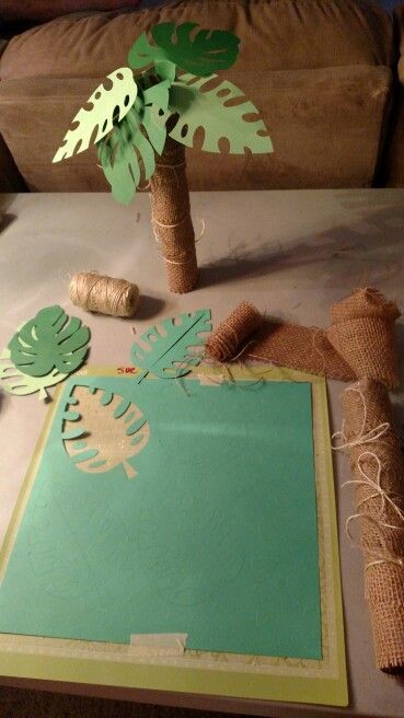 "Palm trees made from paper towel rolls. Using burlap, twine and ""Beach"" cricut cartridge."
