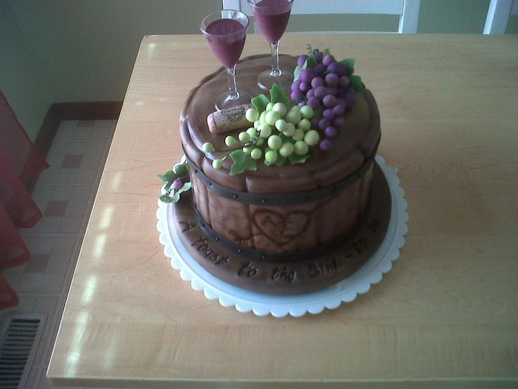 Cake in Shape of Wine Barrel Topped with Two Wine Glasses and Grapes