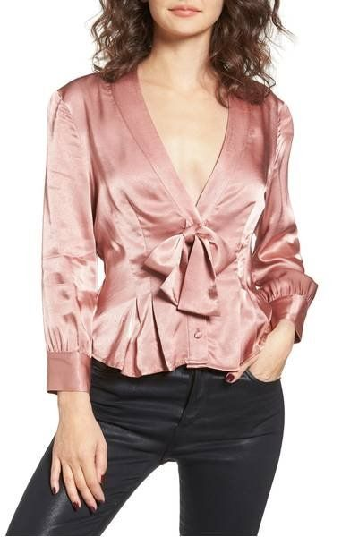 Cut from lustrous satin in a flattering tied silhouette, this fluid blouse draws all eyes to you with its alluring elegance.