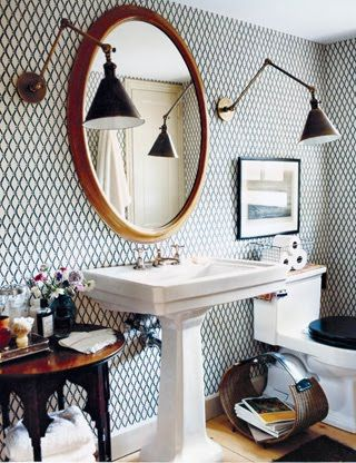Deborah Needleman's bathroom, via Domino I love the lights and wallpaper. Lights are so unexpected