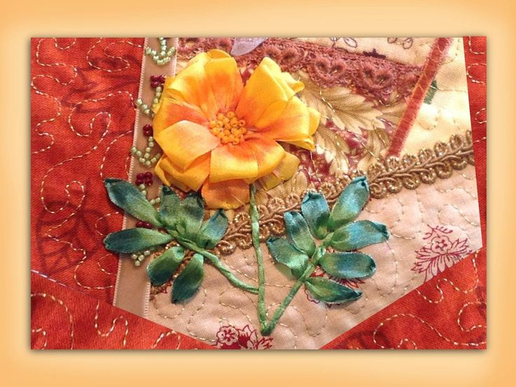 I ❤ ribbon embroidery . . . How to embroider a silk ribbon marigold flower. www.craftyattic.com shows you how to embroider this silk ribbon marigold flower. This straightforward film includes instruction on forming the flower, stem & leaves & shows how to color your finished work.